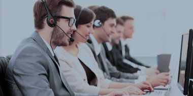 Side view:call center operators in the headphones with microphones sitting in front of computer and work. the photo has a space for your text stock vector