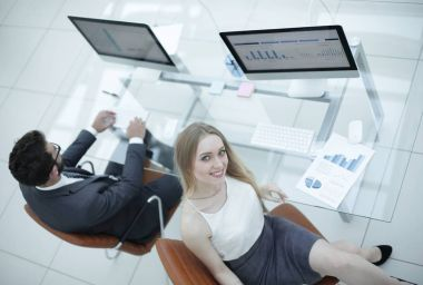 experienced employees of the company working with financial documents.