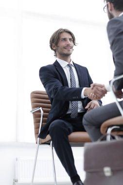 close-up of a businessman holding a briefcase