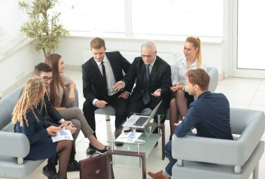 business partners and business team discussing a new contrac