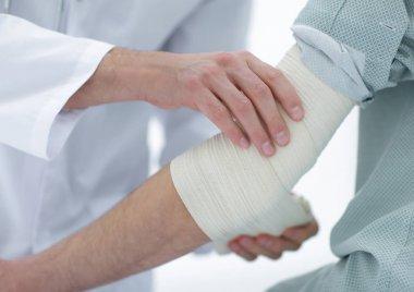 closeup.doctor applying elastic bandage