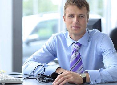 Friendly male helpline operator with headphones