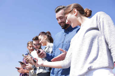 group of young people with modern gadgets