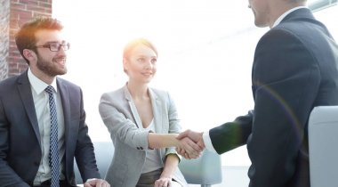 confident handshake business partners