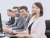 Photo female customer service representative and colleagues in the call center