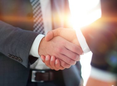 Businessman giving his hand for handshake to partner