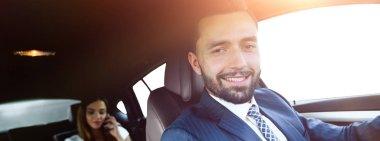 Attractive elegant serious man drives good car