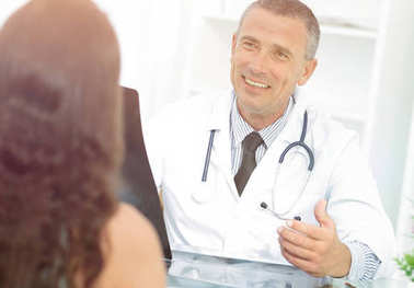 Doctor talking to patient sitting at the table
