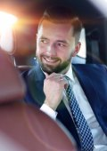 Fotografie Close-up of a successful businessman sitting in a comfortable car