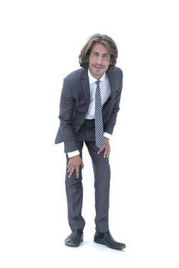 Young handsome businessman bending down.