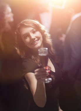 beautiful young woman raising his glass in a casino