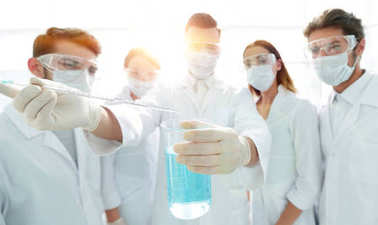 Closeup of a group of medical workers working with liquids in laboratory stock vector