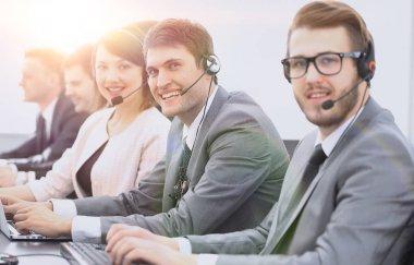Customer service representative and colleagues in the call center stock vector