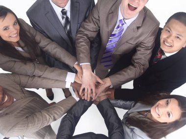 business team standing with hands clasped together