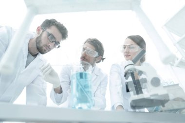 Group of scientists working on an experiment at the laboratory