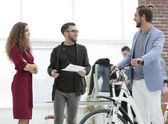 managers discussing with the client the model of the bike