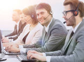 employee call center with headset at workplace