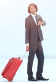 Fotografie businessman with travel suitcase pointing forward