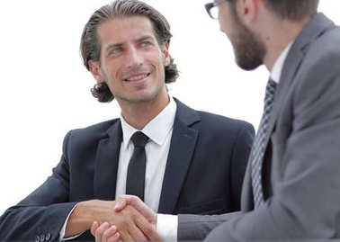 confident handshake colleagues in the office
