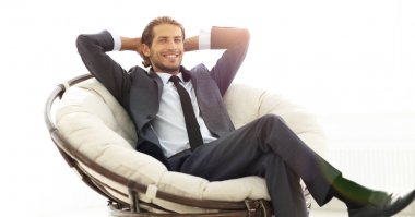 Successful businessman sitting in a large comfortable chair. photo with copy space stock vector