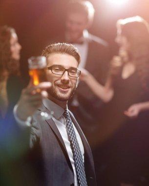 elegant man raising a glass of champagne