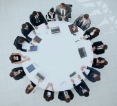 nézet felülről.találkozó üzleti partnerek kerek - asztal.