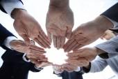 Fotografie koncepce týmové práce a jednoty