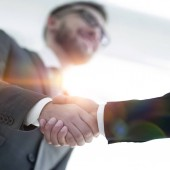 Fotografie Successful business people handshaking after good deal.