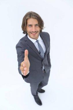 Business man extending hand to shake - focus om hand