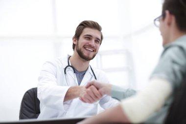 Closeup.Doctor welcoming a patient in his studio stock vector