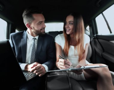 Businessman and businesswoman talking on a move