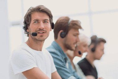 Close up. a group of people in the headset works on personal computers. photo with copy space stock vector