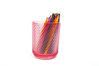Group of color felt-tipped pens in a glass, white background