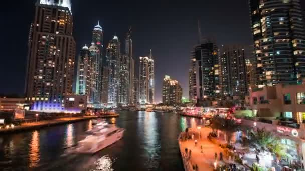 DUBAI, UAE - SEPTEMBER 21, 2014: Timelapse view of Dubai Marina skyscrapers with yachts and boats