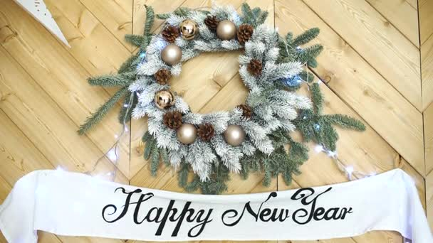 Happy new year sign on christmas tree wreath background