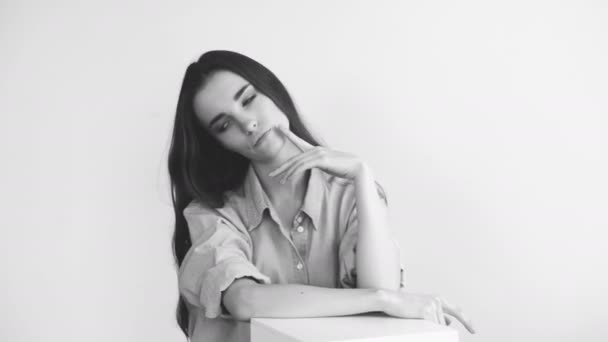 Professional fashion model posing and looking into camera. Woman show poses and emotions