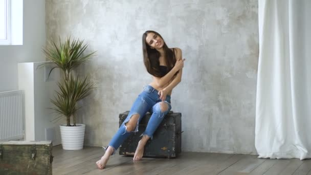 Professional fashion model topless posing and looking into camera. Woman show poses and emotions