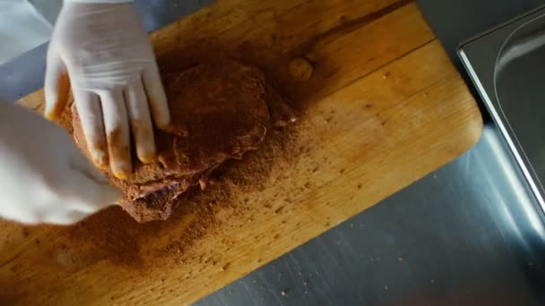 Closeup of professional chef man prepare meat with spice on cutting board at restaurant kitchen