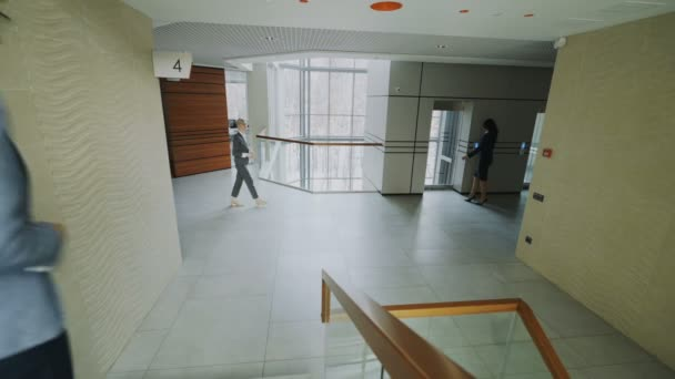 Businessmen and busineswoman colleagues walking and meet in modern office center indoors