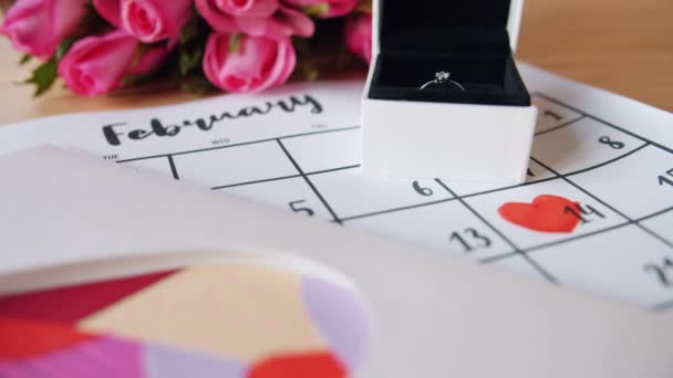 Beautiful celebration of Valentines day with flowers, ring, card and calendar