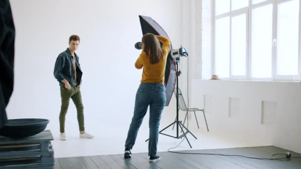 Good-looking man posing for photo camera in studio advertising trendy clothes