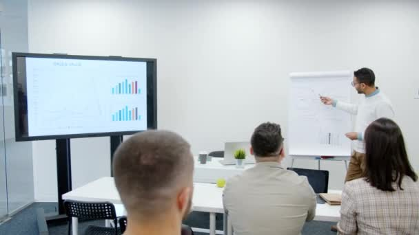 Group of people applauding to business trainer Arab man in conference room