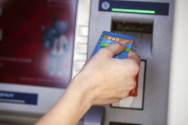 Female arms Take cash from the ATM