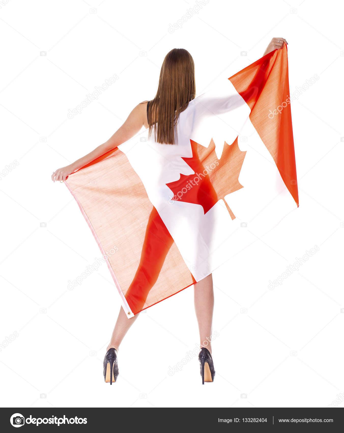 beautiful woman holding a large canadian flag u2014 stock photo