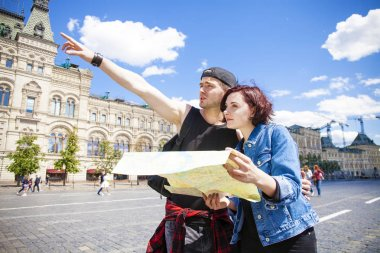 Couple tourists sightseeing city with map. Red Square, Moscow, R