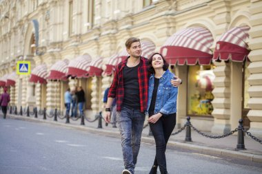 Beautiful young couple on a walk in the city