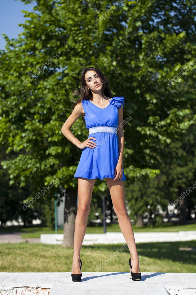 Young Smiling Woman In Blue Dress At The Foun Coedcherry 1