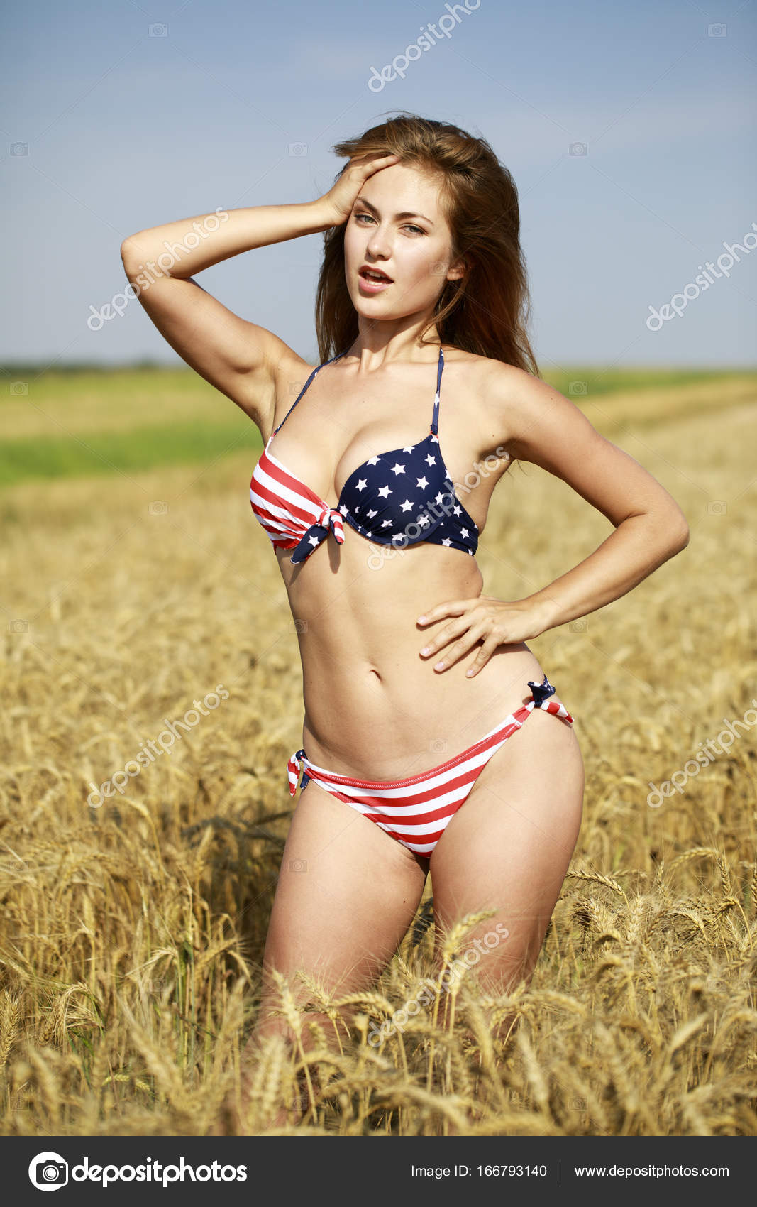 044f7fe584076 Back view, beautiful blonde woman in sexy American flag bikini in a wheat  field — Photo by ...