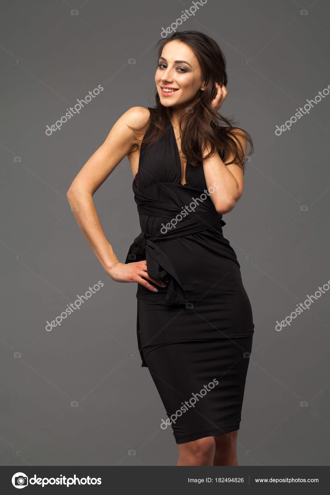 e7fb265255 Beautiful brunette woman in black dress — Stock Photo © arkusha ...