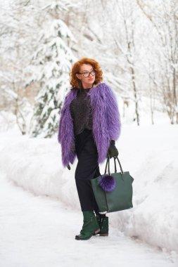 An adult beautiful woman in a fur coat